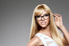 Beauty young woman, luxury long blond hair in glasses. Haircut, Royalty Free Stock Images