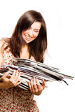 Beauty young woman with magazines. (isolated Royalty Free Stock Photo