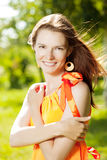 Beauty young woman on nature in the park. Wind in the hair Royalty Free Stock Photo