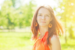 Beauty young woman on nature in the park. Wind in the hair Stock Photography
