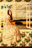 Beauty young woman near the window Stock Photo
