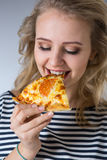 Beauty young woman with pizza Royalty Free Stock Image