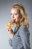 Beauty young woman with pizza Stock Photos