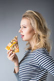 Beauty young woman with pizza Royalty Free Stock Images