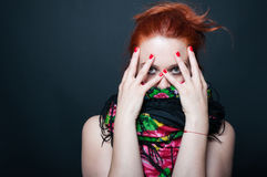 Beauty young woman posing with face covered royalty free stock image