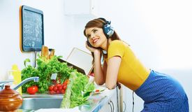 Beauty young woman prepare breakfast in kitchen. Music listening Royalty Free Stock Photo