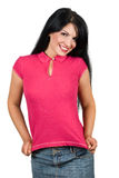 Beauty young woman presenting her blank t-shirt. Cute young woman presenting her blank pink t-shirt,you can add your message text tshirt isolated on white royalty free stock photo
