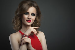 Beauty young woman in red  fashion portrait studio shot Royalty Free Stock Photo