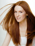 Beauty young woman with red flying hair Royalty Free Stock Images
