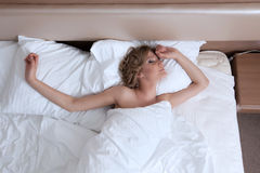 Beauty young woman relax bed in morning room Stock Images