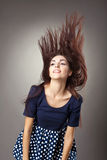 Beauty young woman retro style - hairs blow up Stock Photography