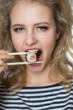 Beauty young woman with  rolls Japanese food Royalty Free Stock Image