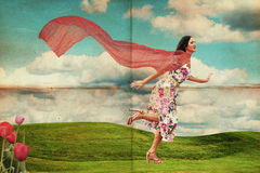 Beauty young woman running on meadow Royalty Free Stock Image