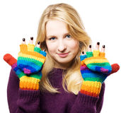 Beauty young woman shows manicure. In colourful gloves (isolated Royalty Free Stock Photo