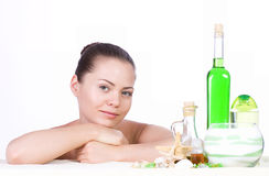 Beauty young woman with spa oils Royalty Free Stock Photos