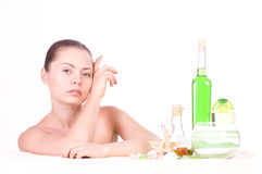 Beauty young woman with spa oils Stock Image