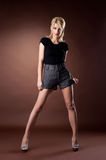 Beauty young woman stand in pin-up style cloth Stock Photography