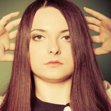 Beauty young woman in straight long hair. Stock Photography