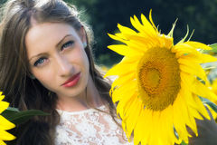 Beauty young woman in sunflower field Stock Image