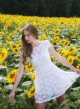 Beauty young woman in sunflower field Stock Images