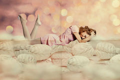 Beauty young woman in a sweet cakes Royalty Free Stock Image
