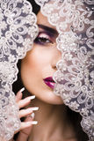 Beauty young woman throw white lace close up Royalty Free Stock Photo