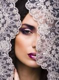 Beauty young woman throw white lace close up Stock Photo