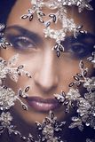 Beauty young woman throw white lace close up, Royalty Free Stock Photography