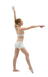 Beauty young woman training in white dress Royalty Free Stock Image