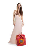 Beauty young woman walk in rose dress Royalty Free Stock Photos