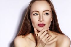 Beauty young Woman on white. Beautiful Model Girl with Makeup, Red Lips, Perfect Fresh Skin. Flirting Expressive Face. Beauty young Woman on white. Beautiful royalty free stock image