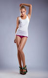 Beauty young woman in white cotton sexy singlet Stock Images