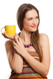 Beauty young woman with yellow cup of tea Stock Photo