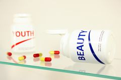 Beauty and youth pills in a bottle Royalty Free Stock Images