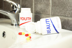 Beauty and youth pills in a bottle, max dof Royalty Free Stock Images