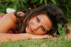 Beautyful, attractive young woman, liying in the grass Royalty Free Stock Photos