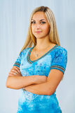 Beautyful blonde on blue background Stock Image