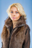 A beautyful blonde in fur coat Stock Image