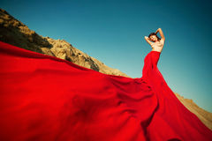 Beautyful brunette with red tissues. Over the sky Royalty Free Stock Image