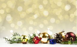 BEAUTYFUL CHRISTMAS DECOR ORNAMENT. GOLDEN BOKEH BACKGROUND. MERRY CHRISTMAS. DECORATIVE ELEMENTS OVERHEAD PHOTO. BEAUTYFUL ORNAMENT TOOLS STILL LIFE. ISOLATED Royalty Free Stock Photography