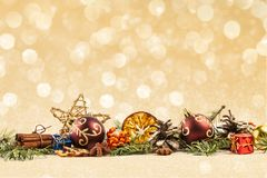 BEAUTYFUL CHRISTMAS DECOR ORNAMENT IN LINE. GOLDEN BOKEH BACKGROUND. MERRY CHRISTMAS. DECORATIVE ELEMENTS OVERHEAD PHOTO. BEAUTYFUL ORNAMENT TOOLS STILL LIFE stock image