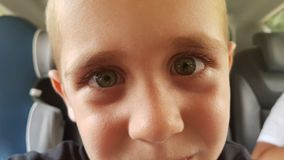Amazing child face. A beautyful closeup of a child with blue eyes stock photos
