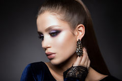 Beautyful girl with bright make up. And beautiful hairstyle stock photo