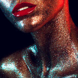 Beautyful girl with gold glitter on her face. And red lips Royalty Free Stock Photos