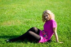 Beautyful girl on grass Stock Images