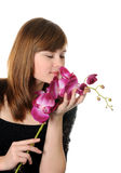 Beautyful girl and orchid Stock Photography