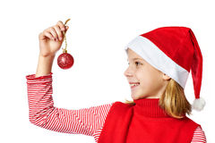 Beautyful girl in red Santa hat with christmas ball Royalty Free Stock Image
