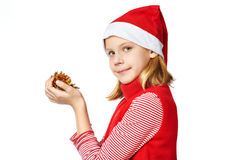 Beautyful girl in red Santa hat with golden pine cones Stock Photo