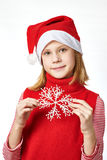Beautyful girl in red Santa hat with snowflake Stock Image