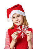 Beautyful girl in red Santa hat with snowflake Royalty Free Stock Photo